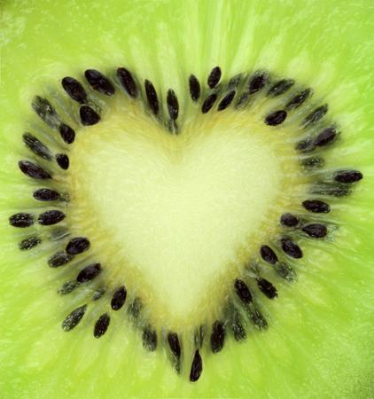 extreme macro:  Kiwi fruit slice texture with heart shape  Extreme macro shot