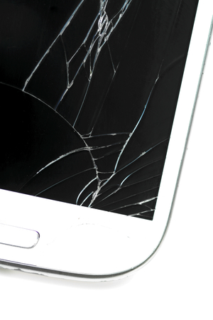 Broken screen smart phone on white  photo