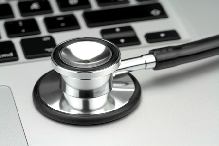 Stethoscope on the keyboard of pc, macro image   photo