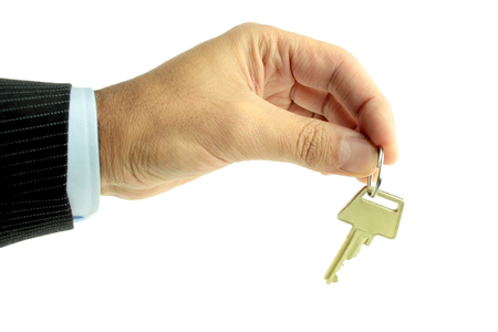 Handing over key on white background photo