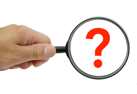 exaggerate: Magnifying glass with red question mark on white background