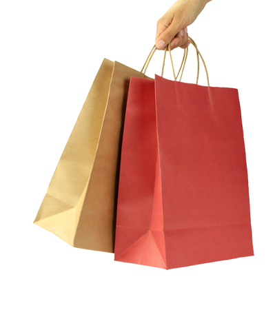 carries: Woman hand carries shopping bags on white background
