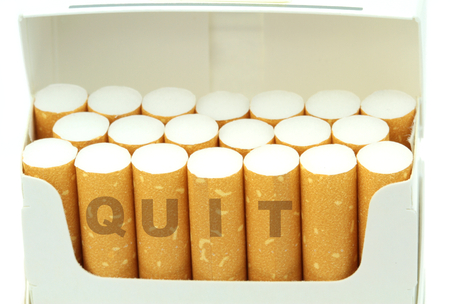 quit smoking: Quit word on cigarettes