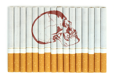 nicotine: image of skull on cigarettes Stock Photo