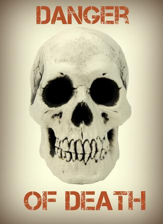mortal danger: Human skull with the sample text danger of death