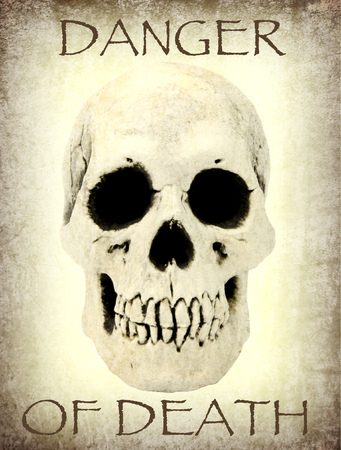 Human skull with the sample text danger of death