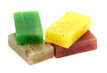 Colorful natural herbal soaps isolated on white background. photo