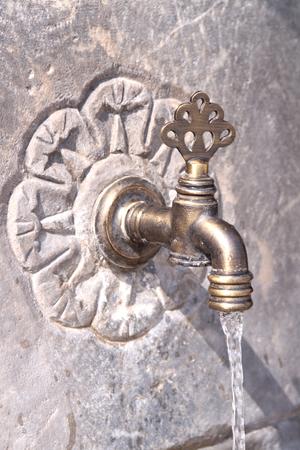 Old Turkish Ottoman style water tap photo