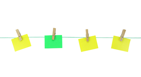 Blank note papers hanging with wood pegs on clothesline photo