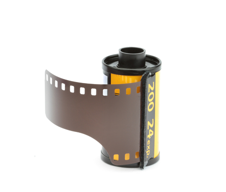 35mm: 35mm photo film reel isolated on white background