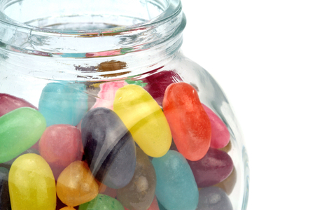 Colorful jelly beans in jar . Macro shot. photo
