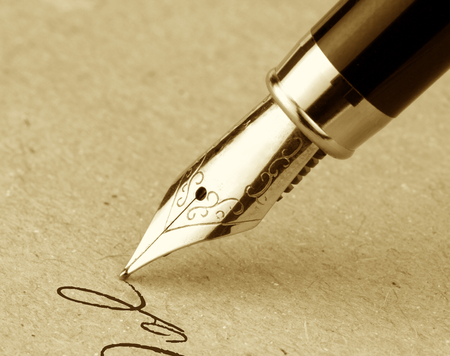 Fountain pen on a old paper with copy space. Vintage image. Stock Photo