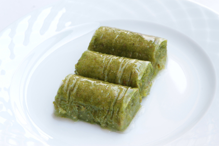 favored: Delicious Turkish sweet, wrapped green pistachio nuts ( Sarma )