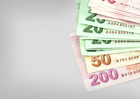 tl: Turkish banknotes. Turkish Lira ( TL ) isolated on white background.