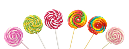 Colorful spiral lollipops on white background Stock Photo