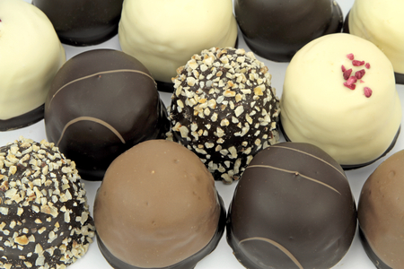 puffs: Chocolate coated cream puffs. Danish cuisine. Stock Photo