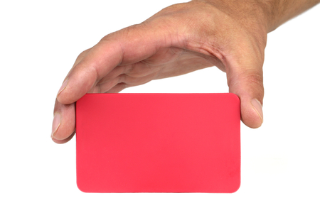 forewarn: Hand holding and showing a red card and copy space. Stock Photo
