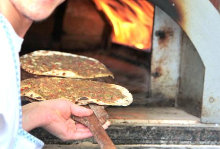 specialty: Delicious Turkish Pizza.  Etli ekmek or Lahmacun Stock Photo