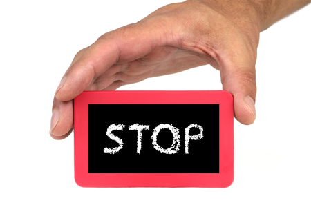 card stop: Hand holding and showing a card with  STOP  text