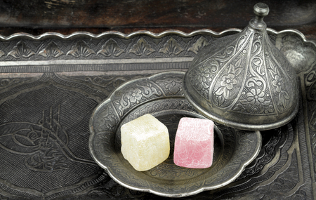 turkish delight: Turkish delight in traditional Ottoman style carved patterned metal plate Stock Photo