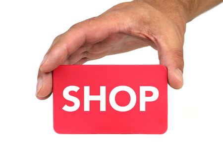 forewarn: Hand holding and showing a red card with  SHOP  text
