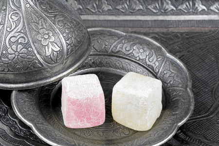 old metal: Turkish delight in traditional Ottoman style carved patterned metal plate Stock Photo