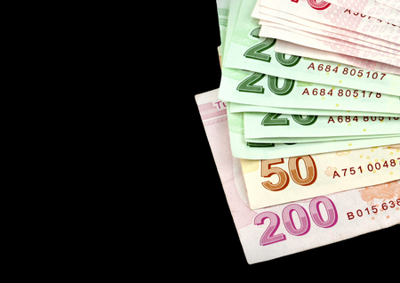 turkish lira: Turkish banknotes. Turkish Lira  TL  on black background.