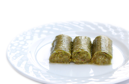 favored: Delicious Turkish sweet, wrapped green pistachio nuts  Sarma Stock Photo