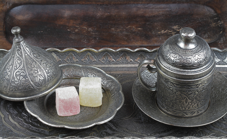 appetising: Turkish delight in traditional Ottoman style carved patterned metal plate and coffee cup