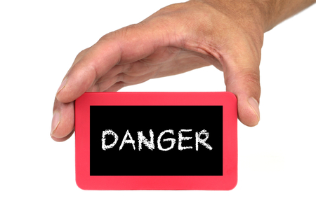 forewarn: Hand holding and showing a card with  DANGER  text