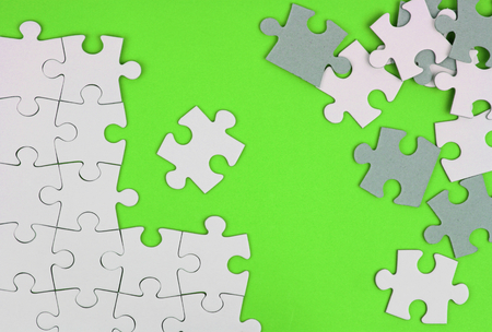 Puzzle pieces on green background