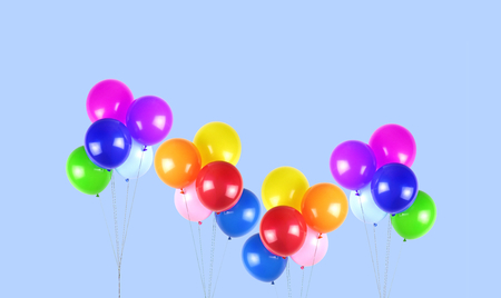 Colorful party balloons on blue background