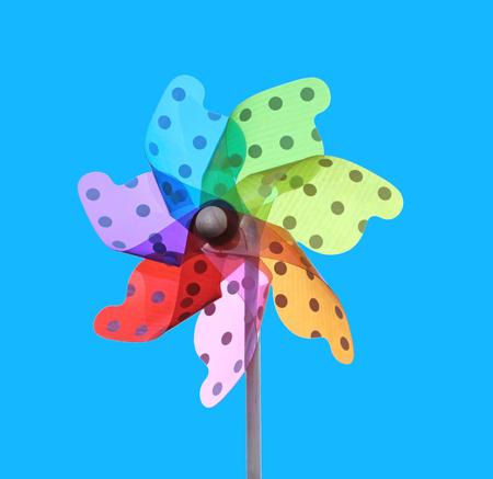 Colorful pinwheel on blue background
