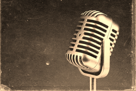 worn paper: Retro microphone. Vintage style or worn paper photo image Stock Photo