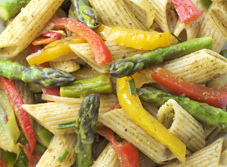 specials: Pasta in roasted asparagus, peppers with green pesto Stock Photo