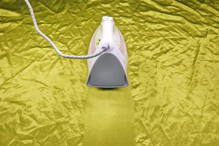 iron on yellow crinkle silk fabric