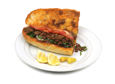 Traditional Turkish cuisine, Tantuni with loaf bread. Isolated on white background.