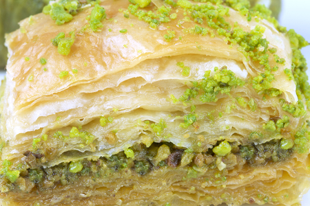 Delicious Turkish baklava and  with green pistachio nuts. Macro image.
