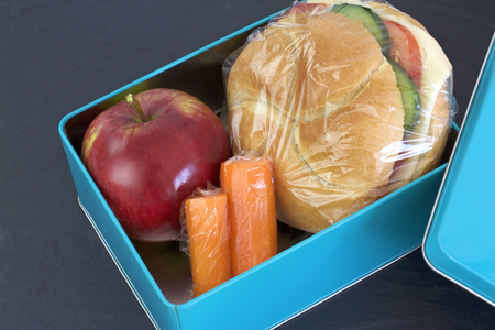 Lunch box, cheese sandwich, apple and carrots