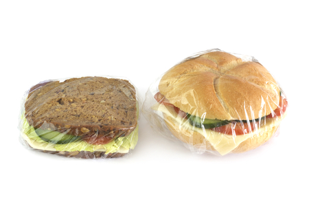 Sandwiches packed with stretch film on white background. Stok Fotoğraf