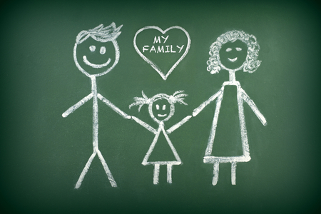 Drawing of family with chalk on blackboard Banco de Imagens