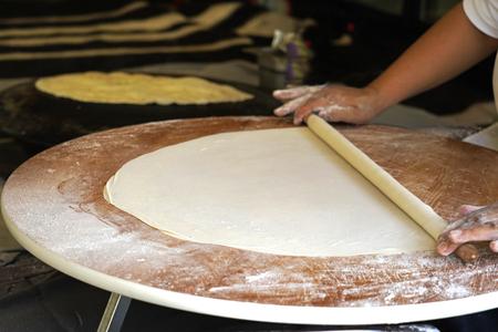 Turkish woman rolling dough