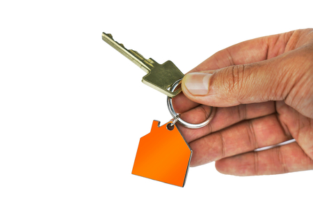 Handing over key with house shape key ring.