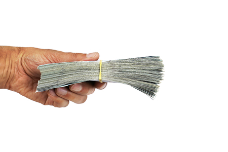 Man holding handful banknotes tied with a rubber band on white background.  Money and financial concept. Reklamní fotografie