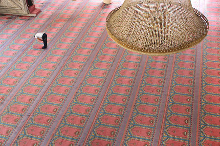 A Muslim praying in the Mosque in Istanbul-Turkey