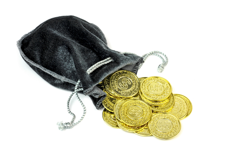 Gold coins in a velvet pouch on white background. Archivio Fotografico