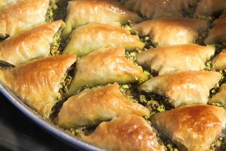 Turkish baklava sobiyet with pistachio nuts.