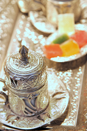 Traditional Turkish coffee with silver metal cup and Turkish delight Imagens