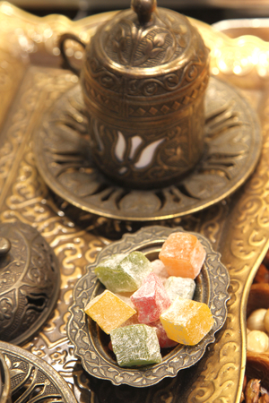 Turkish delight with Ottoman metal plate and coffee cup