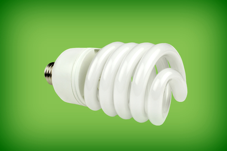 Saving bulb on green background Standard-Bild - 116930190